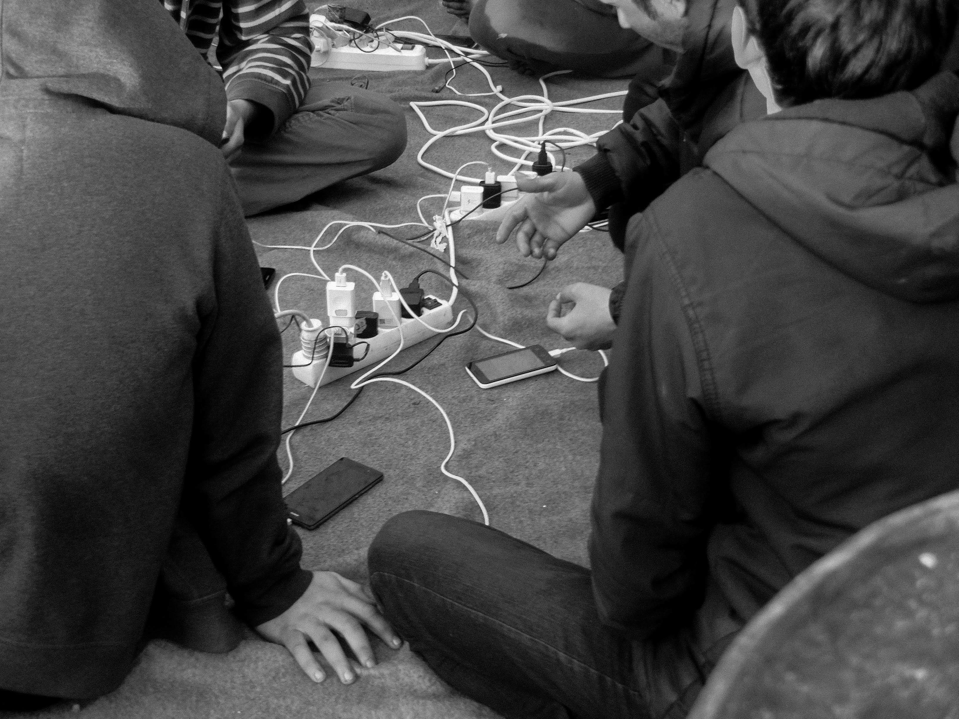 Charging Phones - Serbian Refugees